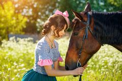 Portrait of a beautiful young woman with a horse stock image