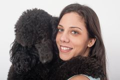 Portrait of a beautiful young woman hugging her beautiful dog stock photos