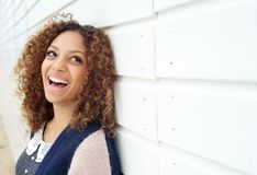 Portrait of a beautiful young woman laughing and looking away Stock Photo