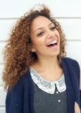 Portrait of a beautiful young woman laughing outdoors Stock Photos