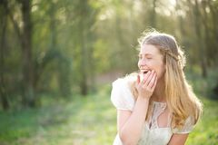 Portrait of a beautiful young woman laughing outdoors Stock Photo