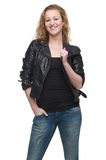 Beautiful Young Woman in Leather Jacket with Hand in Pocket Royalty Free Stock Photos
