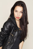 Portrait of beautiful young woman in leather jacket Royalty Free Stock Photography