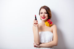 Portrait of beautiful young woman with lipstick on the wonderful. Studio background royalty free stock photos