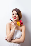 Portrait of beautiful young woman with lipstick on the wonderful Stock Photography