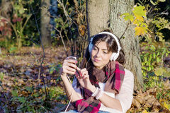 Portrait of beautiful young woman listening music outdoor.Enjoying Music Stock Photos
