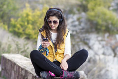 Portrait of beautiful young woman listening music outdoor.Enjoying Music Royalty Free Stock Photography