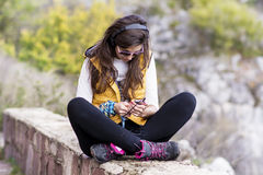 Portrait of beautiful young woman listening music outdoor.Enjoying Music Stock Photography