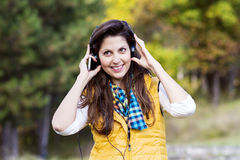 Portrait of beautiful young woman listening music outdoor.Enjoying Music Royalty Free Stock Photo