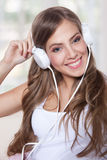 Portrait of a beautiful young woman listening to m Royalty Free Stock Photography