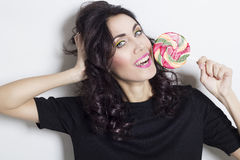 Portrait of beautiful young woman with lollipop Royalty Free Stock Image