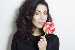 Portrait of beautiful young woman with lollipop Stock Images