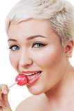 Portrait of beautiful young woman with lollipop Stock Photo