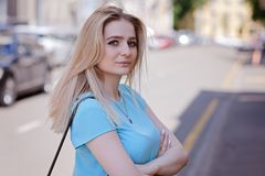 Portrait of beautiful young woman with blond hair and long eyelashes, summer outdoors. Portrait of beautiful young woman with long eyelashes in the city royalty free stock images