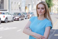 Portrait of beautiful young woman with blond hair and long eyelashes, summer outdoors. Portrait of beautiful young woman with long eyelashes in the city royalty free stock photos