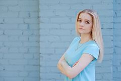 Portrait of beautiful young woman with blond hair and long eyelashes, summer outdoors. Portrait of beautiful young woman with long eyelashes in the city royalty free stock photo