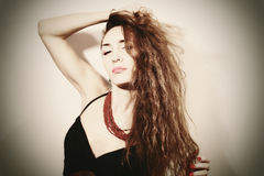 Portrait of a beautiful young woman with long hair Royalty Free Stock Images