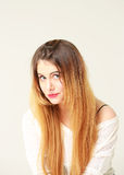Portrait of beautiful young woman with long hair in a white blouse Royalty Free Stock Photography