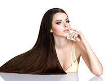 Portrait of beautiful young woman with long straight brown hair Stock Photography