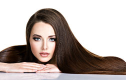 Portrait of beautiful young woman with long straight brown hair Stock Photos