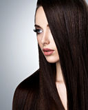 Portrait of beautiful young woman with long straight brown hair Royalty Free Stock Images