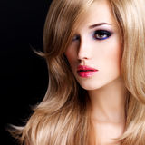 Portrait of a beautiful young woman with long white hairs Stock Image