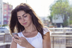 Portrait of beautiful young woman looking her phone Royalty Free Stock Images