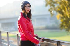 Beautiful young woman looking sideways in the city. Royalty Free Stock Image