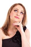 Portrait of a beautiful young woman looking up having an idea Royalty Free Stock Photos