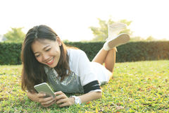 Portrait of beautiful young woman lying and playing and watching Stock Photography