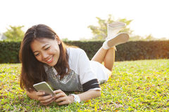 Portrait of beautiful young woman lying and playing and watching Stock Photos