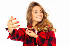 Portrait of a beautiful young woman making selfie on smart phone Stock Image
