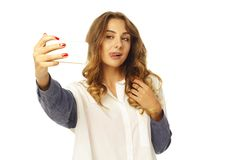 Portrait of a beautiful young woman making selfie on smart phone Stock Photography