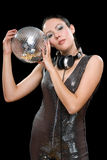 Portrait of beautiful young woman. With a mirror ball in her hands. Isolated on black Stock Image