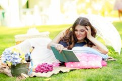 Portrait of a beautiful young woman on nature. Royalty Free Stock Photos