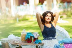 Portrait of a beautiful young woman on nature. Royalty Free Stock Images