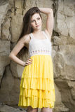 Portrait of a beautiful young woman on nature. Girl in a knitted dress in the rocks Royalty Free Stock Images