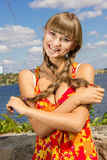 Portrait of a beautiful young woman in nature. With long brown hair braided in a long bright dress and bright makeup Stock Image