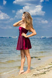 Portrait of a beautiful young woman in nature. With long brown hair in a short dress Royalty Free Stock Photos
