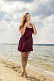 Portrait of a beautiful young woman in nature. With long brown hair in a short dress Stock Images