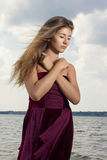 Portrait of a beautiful young woman in nature. With long brown hair in a short dress Royalty Free Stock Images
