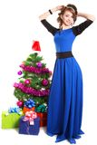 Portrait of a beautiful young woman near the Christmas tree and. Presents isolated over white background Stock Photos