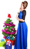 Portrait of a beautiful young woman near the Christmas tree and Royalty Free Stock Photos