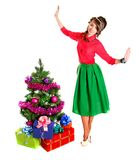 Portrait of a beautiful young woman near the Christmas tree and. Presents isolated over white background Royalty Free Stock Photography
