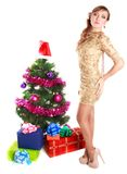Portrait of a beautiful young woman near the Christmas tree and. Presents isolated over white background Stock Images