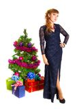 Portrait of a beautiful young woman near the Christmas tree and stock images