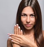 Portrait of a beautiful young woman with a nice manicure Stock Photography