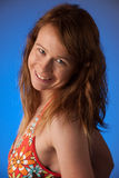 Portrait of a beautiful young woman in orange summer dress Royalty Free Stock Image