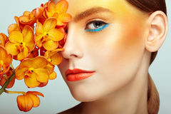 Portrait of beautiful young woman with orchid royalty free stock photo
