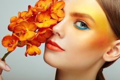 Portrait of beautiful young woman with orchid stock photography